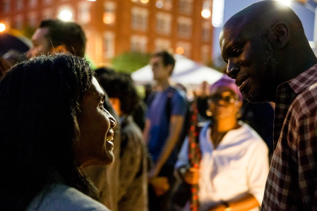 Julia Elias spoke to Dane Felicien, a family friend of Botham Shem Jean, during a Mothers Against Police Brutality candlelight vigil for Jean at the Jack Evans Police Headquarters on Friday in Dallas. He was shot by a Dallas police officer who mistook his apartment for hers on Thursday night. (Shaban Athuman/ The Dallas Morning News)   ORG XMIT: 20041716A