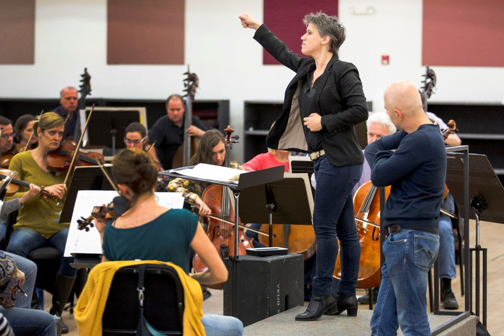 Alexandra Cravero conducts the Dallas Opera Orchestra in rehearsal under the eye of Italian maestro Carlo Montanaro. (Smiley N. Pool/Staff Photographer)