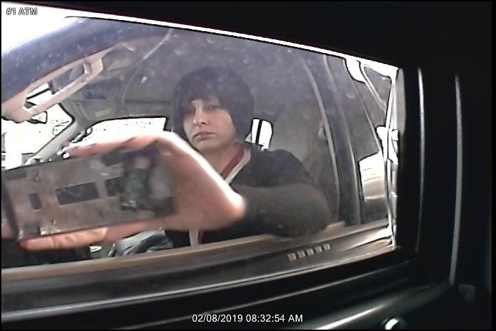 Surveillance footage showed a woman apparently installing a skimming device on an ATM in Hurst last week.