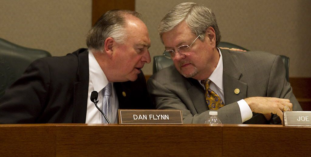 Homeland Security and Public Safety Committee members Rep. Dan Flynn, left, and Rep. Joe Driver confer during a committee hearing on a House bill that would allow allow firearms on college campuses.  (Lary Kolvoord/Austin American-Statesman