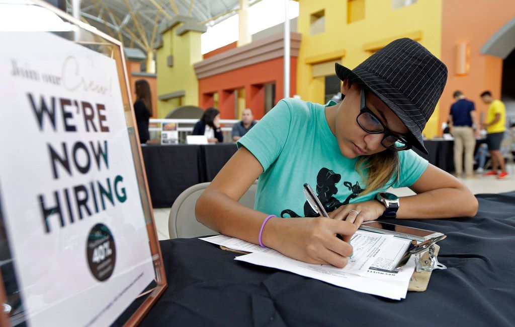 FILE - In this Oct. 3, 2017 file photo, job seeker Alejandra Bastidas fills out an application at a job fair at Dolphin Mall in Sweetwater, Fla.  U.S. businesses added 219,000 jobs in July 2018, a private survey found, a robust total that suggests employers are still able to find the workers they need despite the low unemployment rate. Payroll processor ADP says hiring was led by health care providers, hotels and restaurants, and manufacturers. July's figure was up from 181,000 in June and is enough to lower the already-low jobless rate of 4 percent. (AP Photo/Alan Diaz, File)