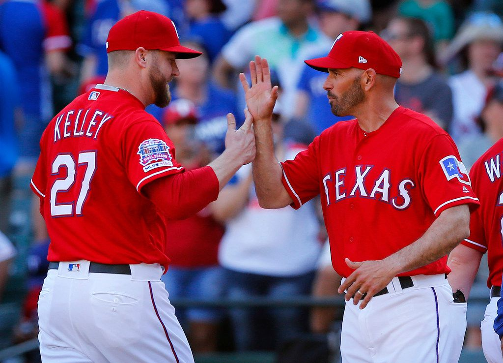 Texas Rangers relief pitcher Shawn Kelley is congratulated by manager Chris Woodward after getting the save against the Houston Astros, 11-10, at Globe Life Park in Arlington, Texas, April 21, 2019. (Tom Fox/The Dallas Morning News)