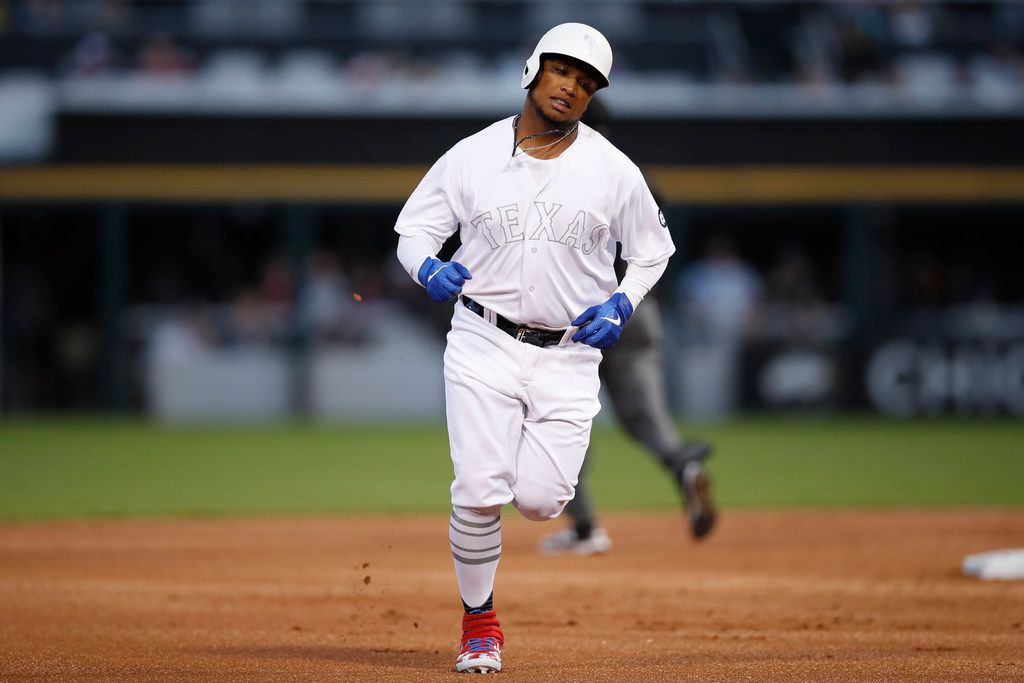 Texas Rangers' Willie Calhoun rounds the bases after hitting a three-run home run during the first inning of a baseball game against the Chicago White Sox, Friday, Aug. 23, 2019, in Chicago. (AP Photo/Jeff Haynes)