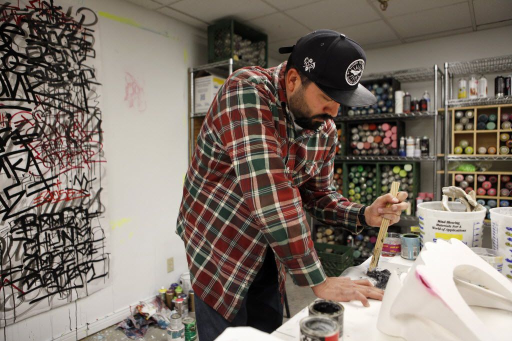Urban Artist DOSE at  work in his studio at the Fairmont Dallas Hotel, where he was the artist-in-residence, photographed March 5, 2013.  (Evans Caglage/The Dallas Morning News)