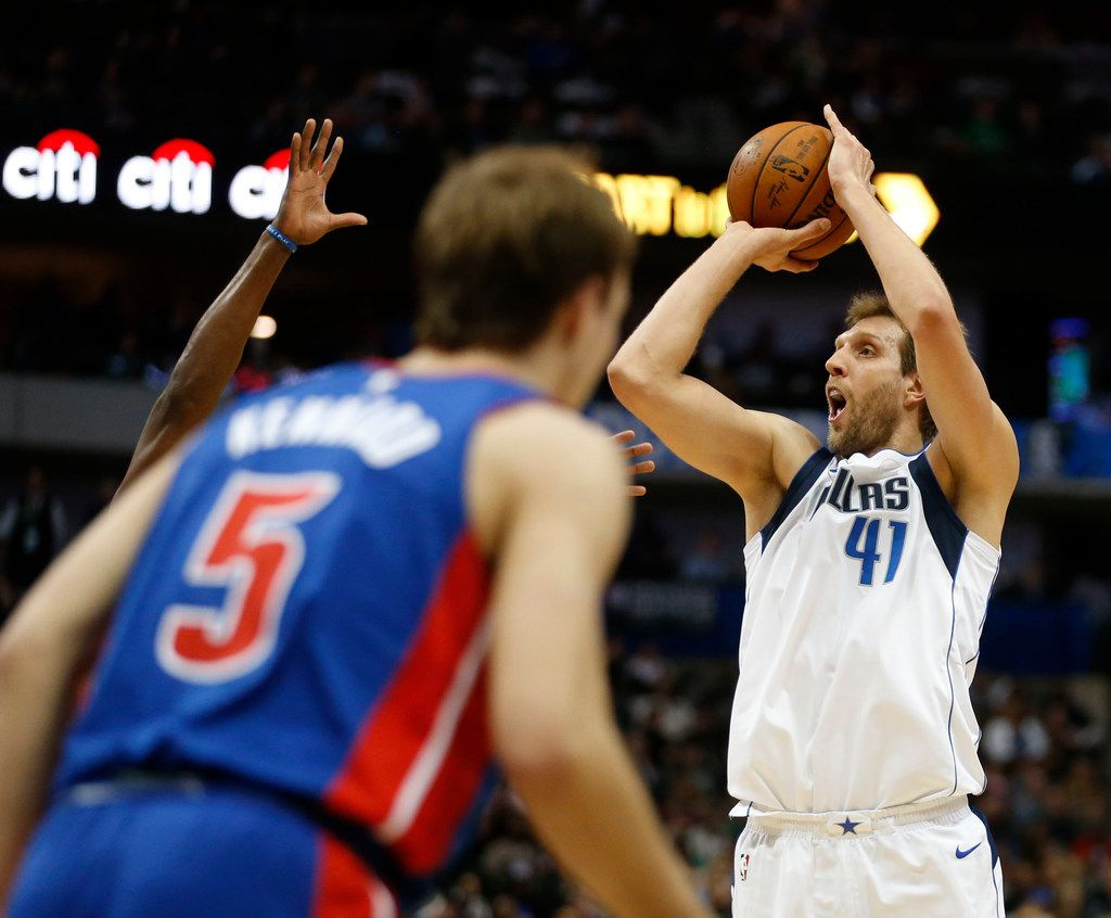 Dallas Mavericks forward Dirk Nowitzki (41) attempts a three pointer in a game against the Detroit Pistons during the first half of play at American Airlines Center in Dallas on Wednesday, December 20, 2017. (Vernon Bryant/The Dallas Morning News)