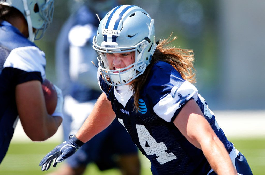 Dallas Cowboys rookie linebacker Lucas Wacha (44) of Wyoming pounds the pads as he runs through drills during organized team activities at The Star in Frisco, Texas, Wednesday, May 24, 2017. (Tom Fox/The Dallas Morning News)