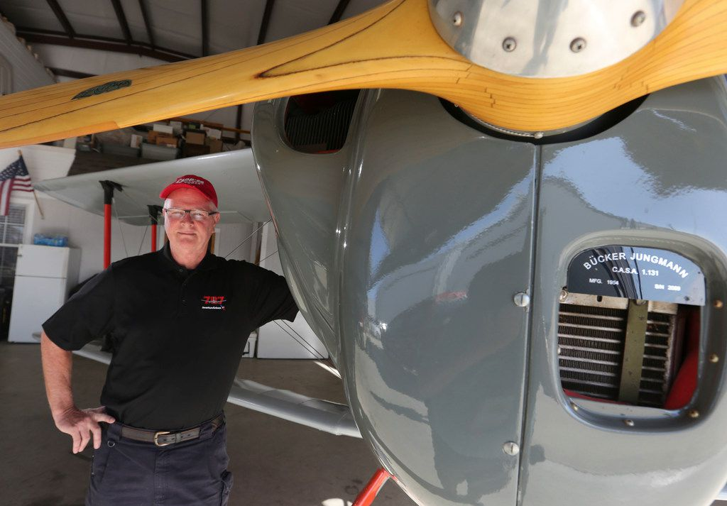Retired American Airlines pilot Captain Jeff Rowland poses with 1934 Bucker Jungmann at Hicks Airfield in Fort Worth Wednesday, January 31, 2018. He retired from the airline last week with 33 years of service. He updated the bi-plane in 1978 with an American instruments and engine. His son, Max Rowland, now owns the plane.  (Ron Baselice/The Dallas Morning News)