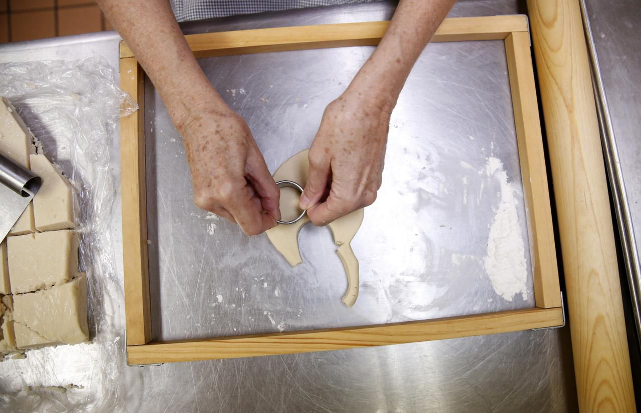 Assistant baker Susie McMinn cuts out the dough in the kitchen of Westminster Presbyterian Church in Dallas.