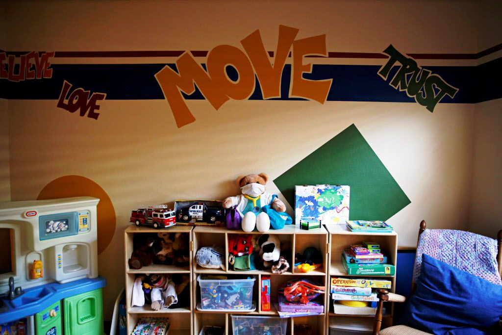 Stuffed animals, toys and board games are found in a room used for treatment and therapy at a children's emergency shelter in Garland.