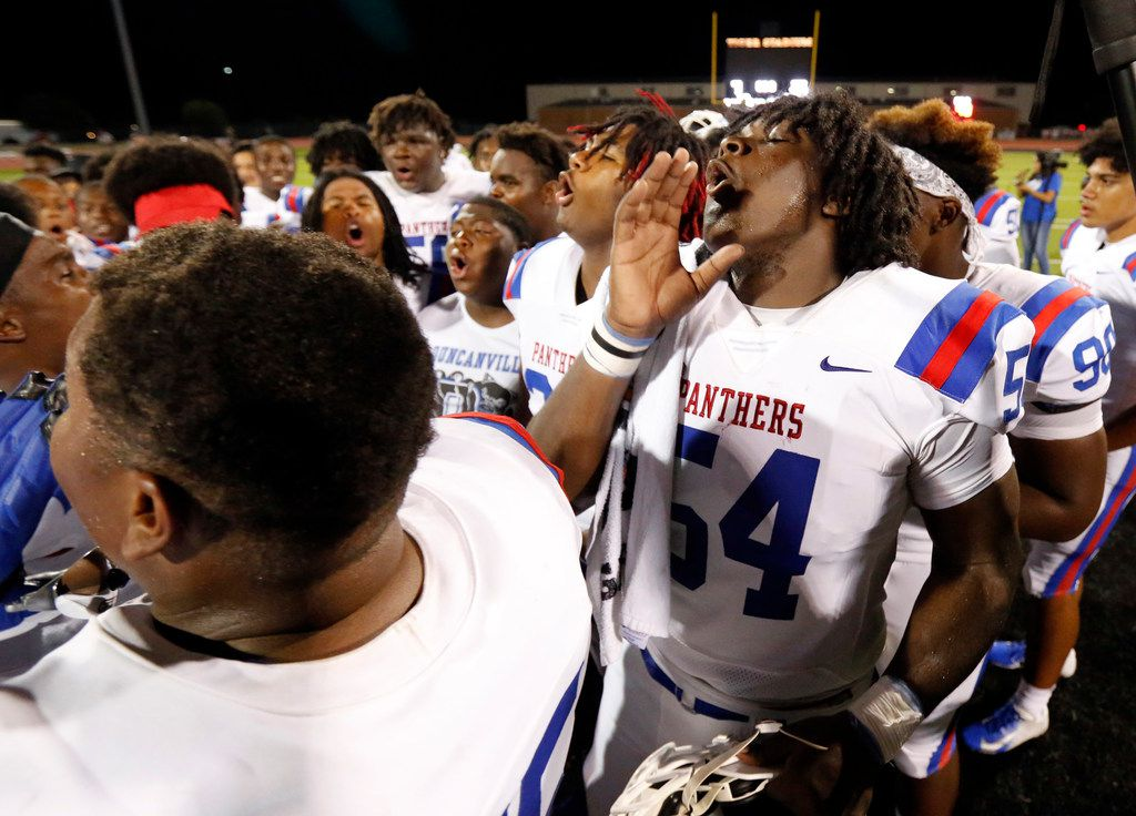 Duncanville's Savion Byrd (54) and his teammates howl after defeating Lancaster, 24-3, at Beverly D. Humphrey Tiger Stadium in Lancaster Texas, Friday, August 30, 2019. (Tom Fox/The Dallas Morning News)