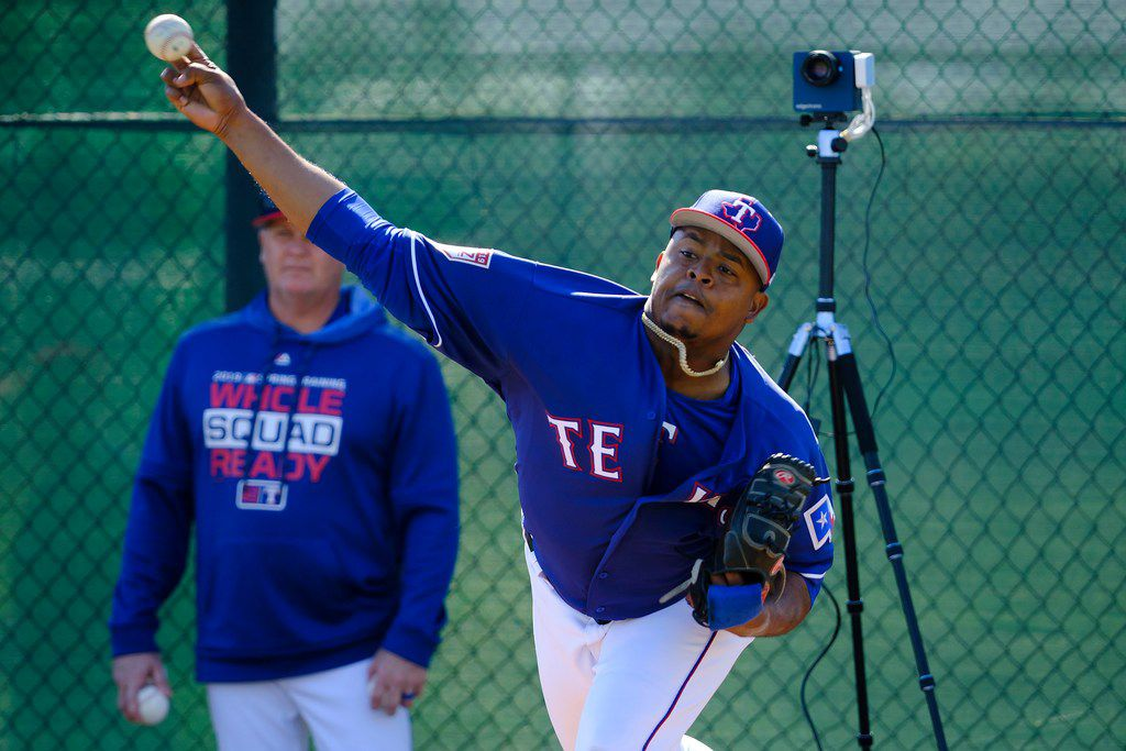Texas Rangers pitcher Edinson Volquez throws in the bullpen during a spring training workout at the team's training facility on Sunday, Feb. 17, 2019, in Surprise, Ariz.. (Smiley N. Pool/The Dallas Morning News)