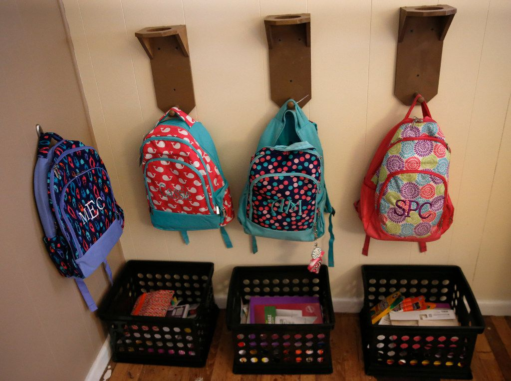 Backpacks and schoolwork were organized for Angela Cook's children and foster children at their home in Mineral Wells in July 2016. (Nathan Hunsinger/The Dallas Morning News)