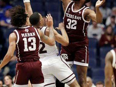 Texas A&M forward Josh Nebo (32) blocks a shot by Mississippi State guard Robert Woodard (12) in the first half of an NCAA college basketball game at the Southeastern Conference tournament Thursday, March 14, 2019, in Nashville, Tenn. (AP Photo/Mark Humphrey)