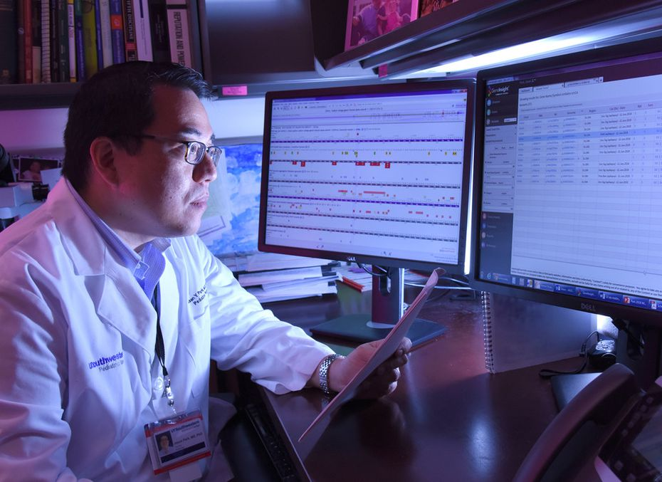 Dr. Jason Park, a UT Southwestern researcher and lead author of the study, examines genetic data.