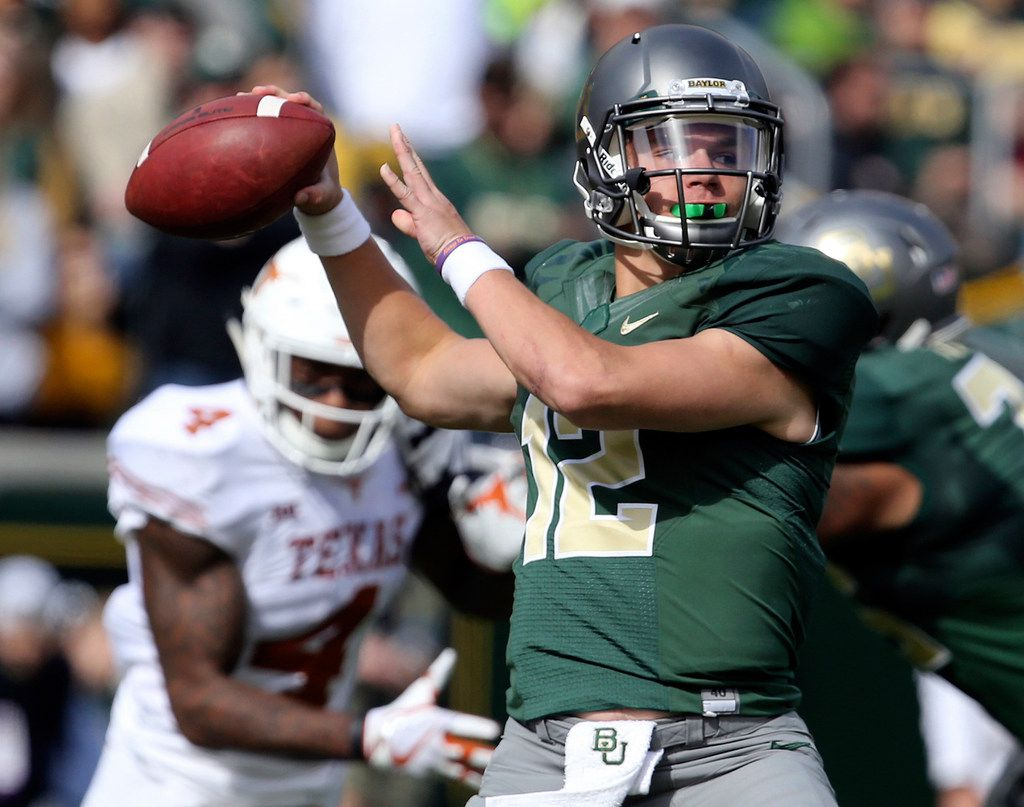 FILE - In this Oct. 28, 2017, file photo, Baylor quarterback Charlie Brewer throws downfield against Texas in the first half of an NCAA college football game, Saturday, Oct. 28, 2017, in Waco, Texas. The Bears' offense has improved ever since they turned to freshman Charlie Brewer in late October.