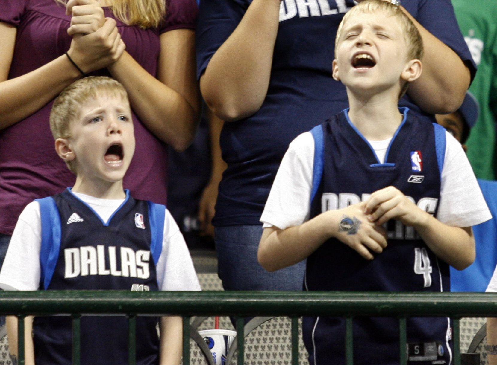 Brothers Anthony (left) and Austin Cooley  of Mesquite learned early to cheer on the hometown team.