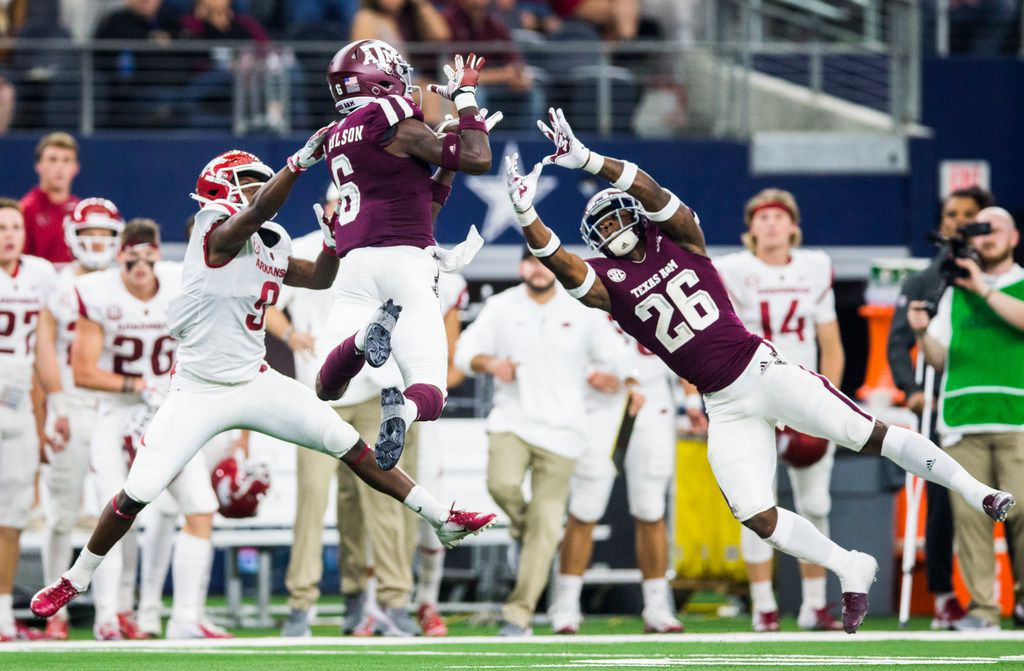 FILE - Texas A&M defensive back Donovan Wilson (6) intercepts a pass intended for Arkansas wide receiver De'Vion Warren (9) during the fourth quarter of a game on Saturday, Sept. 29, 2018, at AT&T Stadium in Arlington.