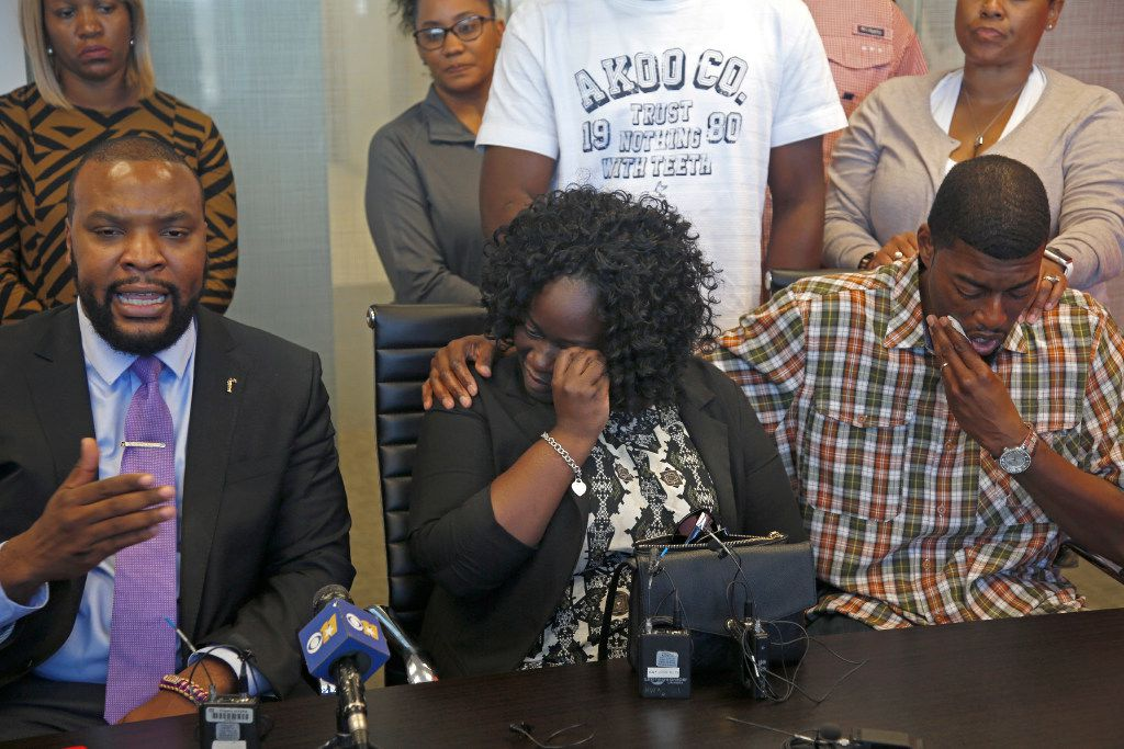Charmaine and Odell Edwards wipe away tears as their attorney, Lee Merritt, talks Monday about the death of their son, Jordan Edwards, in a police shooting Saturday in Balch Springs.