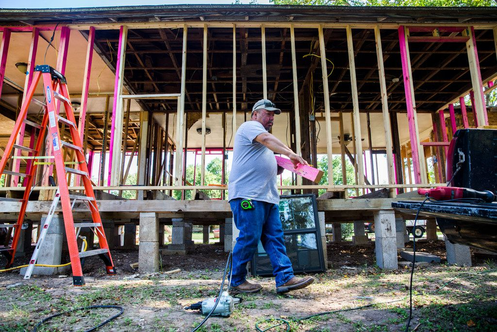 Ricky Villanueva works on his house that had severe flood damage on Oct. 11, 2017, on Colorado Street in La Grange. Major flooding damaged hundreds of homes in the city due to flooding from Hurricane Harvey in late August. Record amounts of rain caused the Colorado River, which borders La Grange, to rise to about 54 feet.