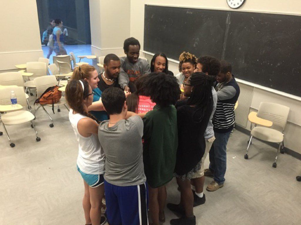 UT biology major Kendrex White (third from left, in black) participated in an icebreaker with other students. He regularly volunteered at Real Role Models, a student organization that volunteered at elementary school.