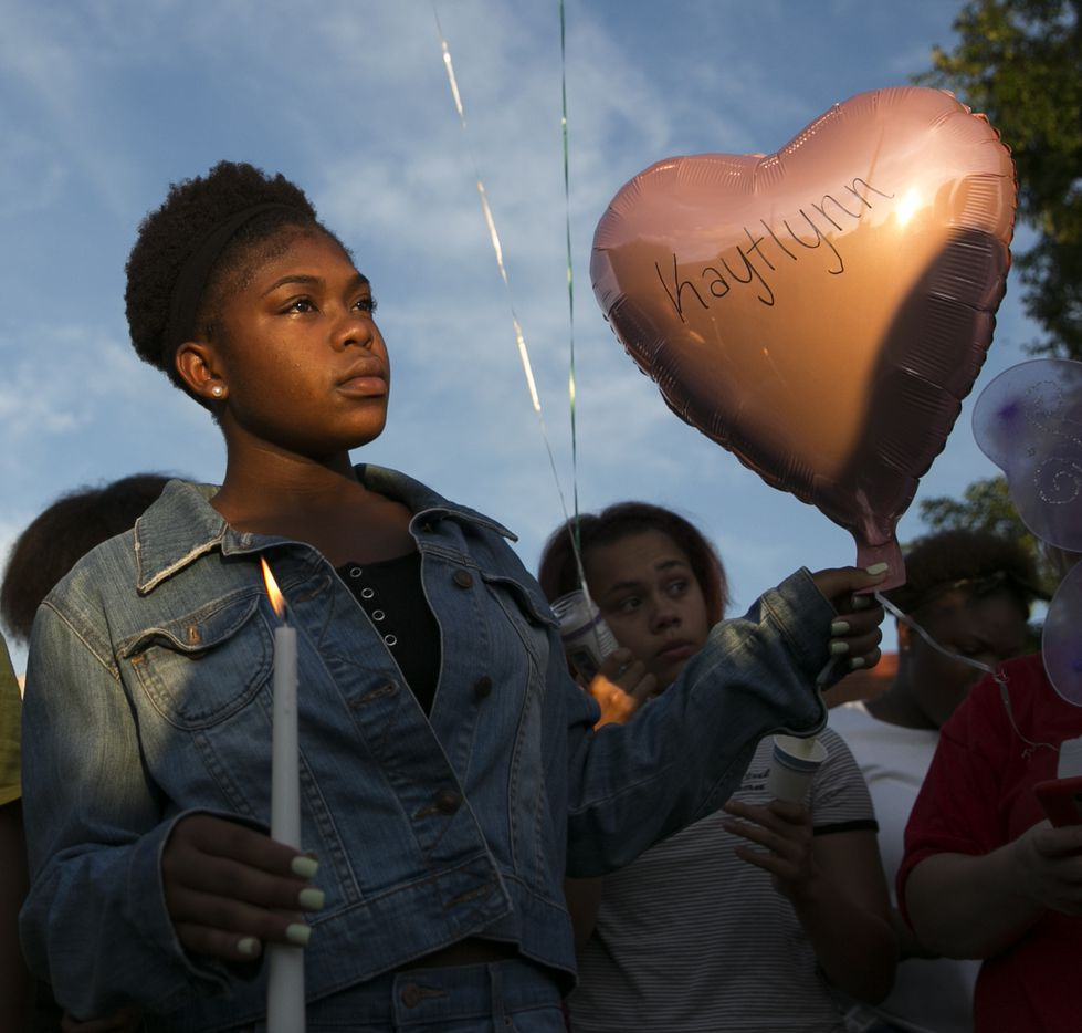 Tracarria Camper, 13, holds a balloon and candle during a prayer vigil held in honor of Kaytlynn Cargill at Central Junior High School in Euless on Thursday.