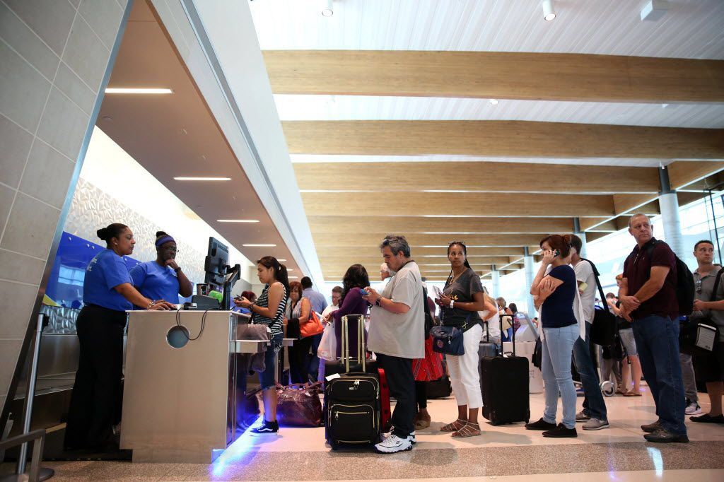 Passengers wait in line at the Southwest Airlines terminal at Dallas Love Field Airport in Dallas on Wednesday, July 20, 2016. Technical issues disrupted Southwest Airlines' operations system wide, including Love Field, grounding flights and causing long lines at airports across the country. (Rose Baca/The Dallas Morning News)