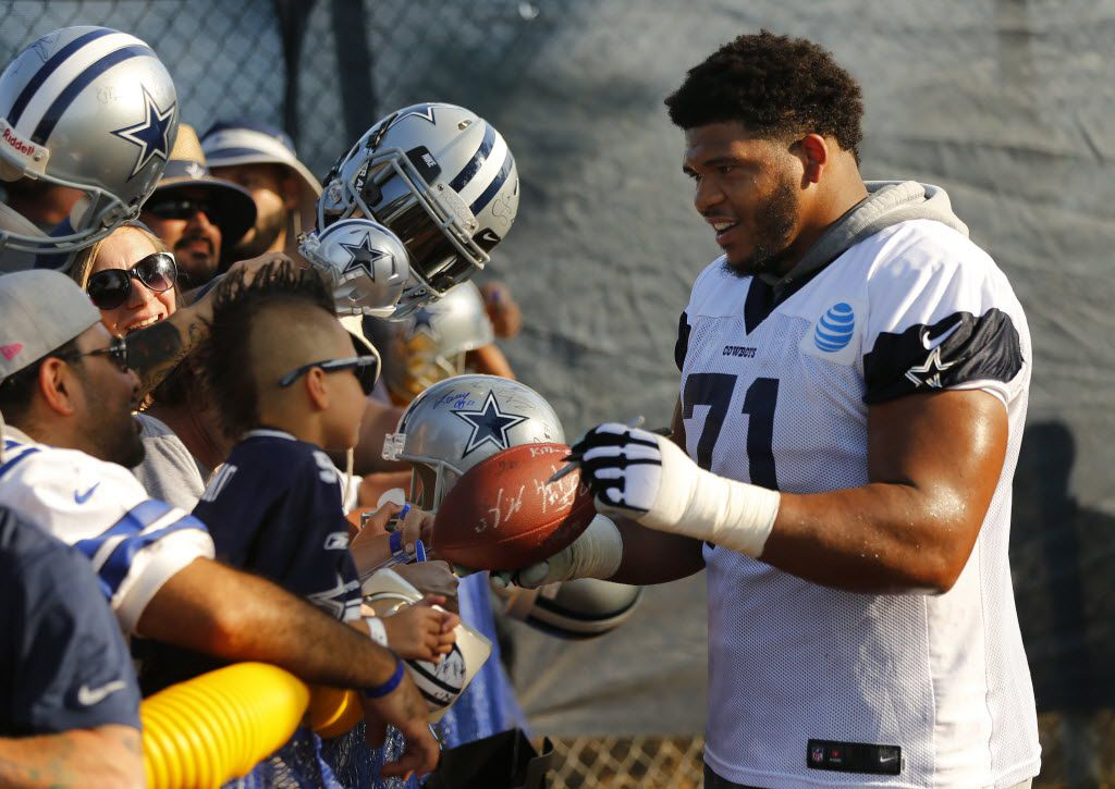 Dallas Cowboys offensive guard La'el Collins (71) signs an autograph for a fan during afternoon practice at training camp in Oxnard, California, Sunday, July 31, 2016. (Tom Fox/The Dallas Morning News)