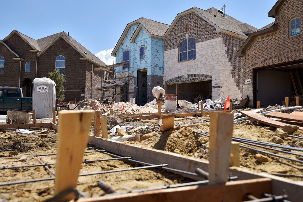 Construction sites for Lennar Homes sit at the subdivision University Place in north Dallas on Aug. 6, 2018.