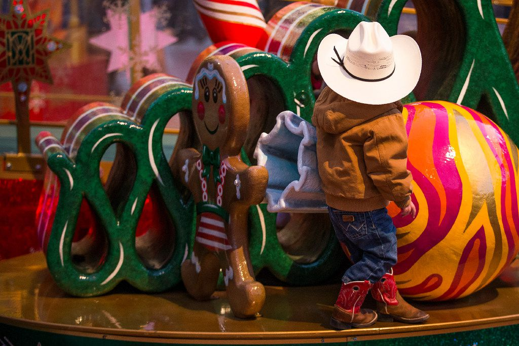 A youngster climbed on decorations in Sundance Square before the XTO Energy 2016 Parade of Lights last month in Fort Worth.