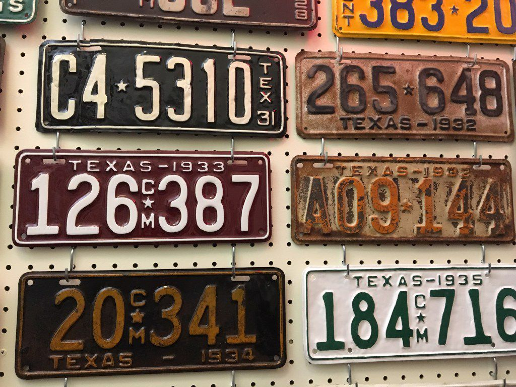 Former state Rep. Joe Pickett, D-El Paso, had nearly 160 vintage Texas license plates on the walls of his Capitol office in 2017. In the middle row are two plates from 1933, with burnt orange against a white background on right, commemorating the University of Texas, and white on maroon at left, honoring Texas A&M University.