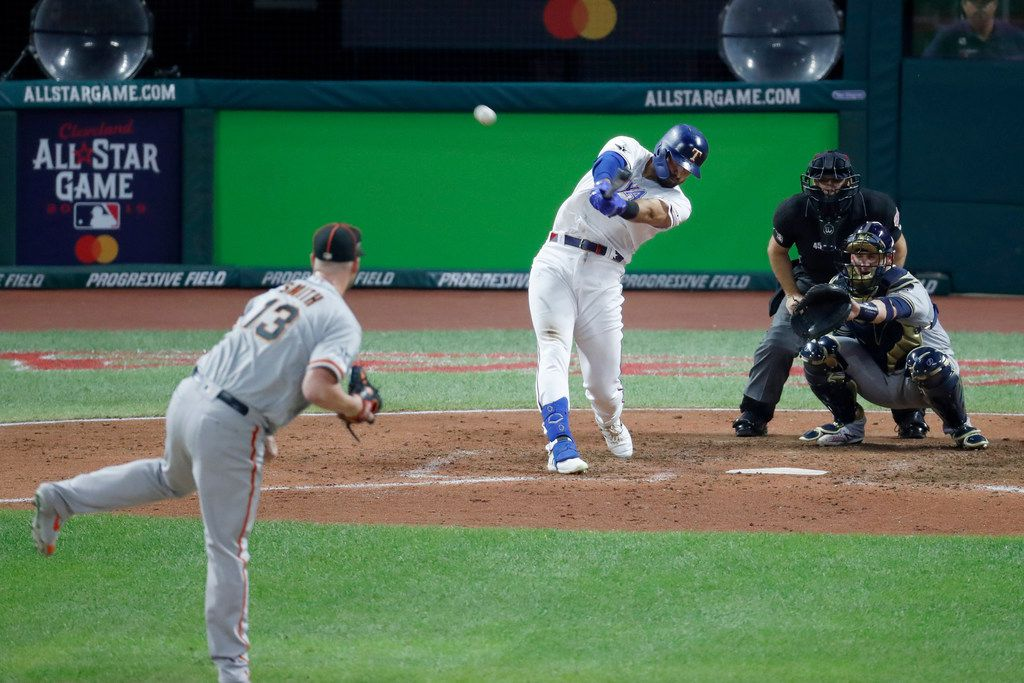 American League's Joey Gallo, of the Texas Rangers, hits a solo home run off National League pitcher Will Smith (13), of the San Francisco Giants, during the seventh inning of the MLB baseball All-Star Game, Tuesday, July 9, 2019, in Cleveland. (AP Photo/Ron Schwane)