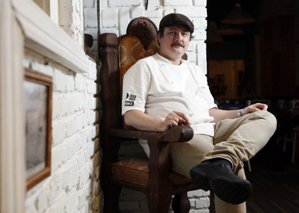 """Chef-owner Tim Byres of the restaurant Smoke on March 4, 2015. The chair Byres sits on used to belong to actor Burt Reynolds and was used as his """"head chair"""" at his dining table."""