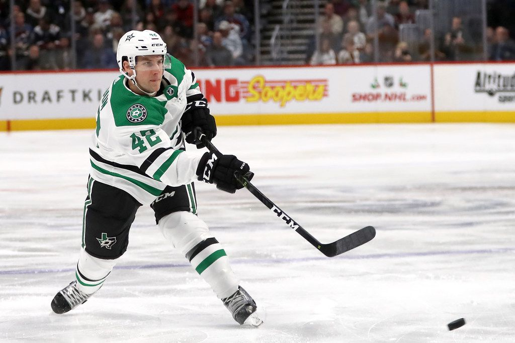 DENVER, CO - NOVEMBER 24: Taylor Fedun #42 of the Dallas Stars fires a shot against the Colorado Avalanche at the Pepsi Center on November 24, 2018 in Denver, Colorado.  (Photo by Matthew Stockman/Getty Images)