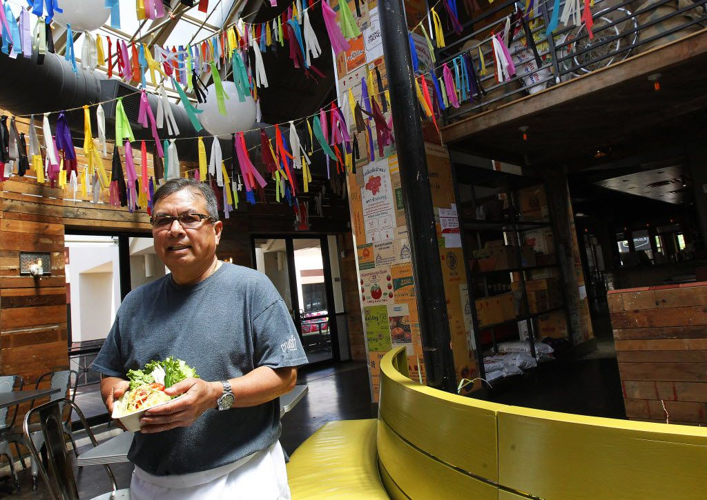 Executive Chef Paul Singhapong of CrushCraft, Thai street eats, will be making a Green Papaya Salad for his mom on Mother's Day.  On Thursday afternoon, April 24, 2014, Chef Singhapong prepared the salad which includes green papaya, tomatoes, tamarind, Thai chiles , fresh squeezed lime juice, and crushed peanuts.   (Mona Reeder/The Dallas Morning News) 05072014xARTSLIFE 05072014xBRIEFING