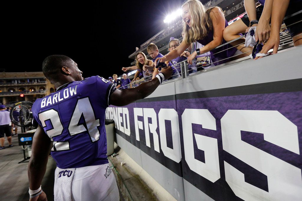 TCU Horned Frogs running back Darwin Barlow (24) gives away his gloves to a fan as they defeat Arkansas-Pine Bluff Golden Lions at Amon G. Carter Stadium in Fort Worth Texas, Saturday, August 31, 2019. TCU defeated Arkansas-Pine Bluff, 39-7. (Tom Fox/The Dallas Morning News)