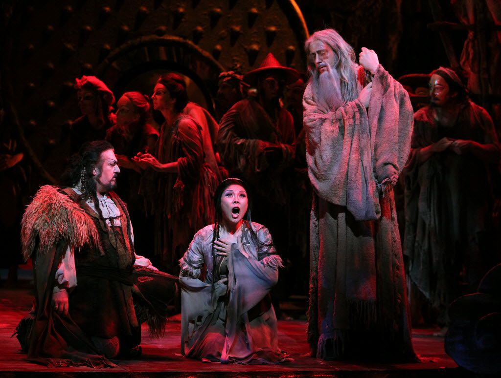 Liu, played by Hei-Kyung Hong, sings her part between Calaf, played by Antonello Palombi (left) and Timur, player Christian Van Horn during the dress rehearsal for the Turandot at the Winspear Opera House in Dallas in 2013.