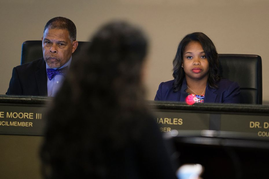 Council member Candice Quarles (right) and Mayor Pro Tem Kenzie Moore III listen as resident Dorothy Ann Dauenhauer implores them to respond to public concerns. (Smiley N. Pool/The Dallas Morning News)