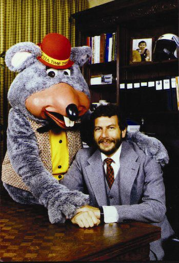 Chuck E. Cheese founder Nolan Bushnell with the Chuck E. Cheese character.