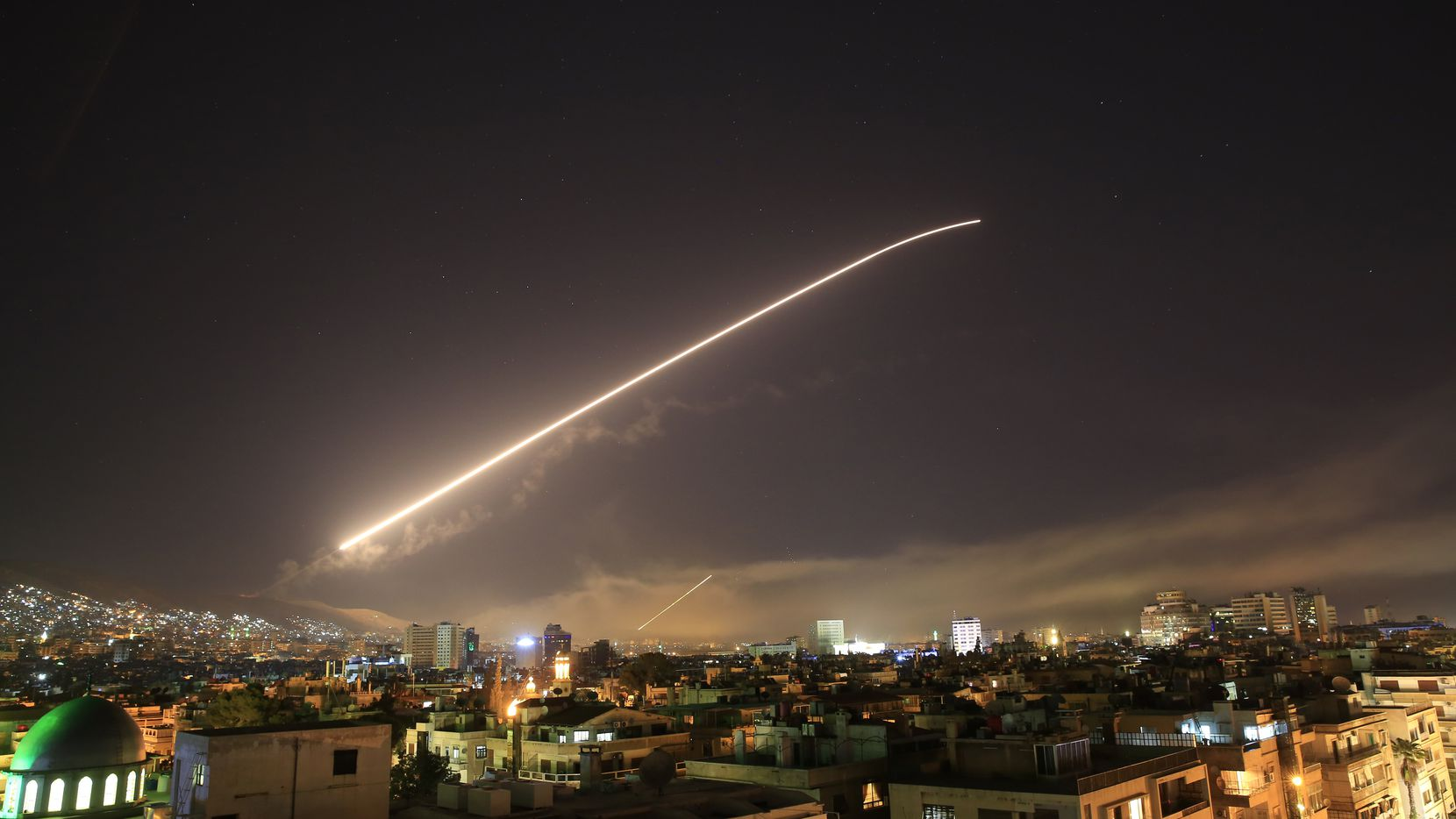 The Damascus sky lights up with missile fire as the U.S. launches an attack on Syria.