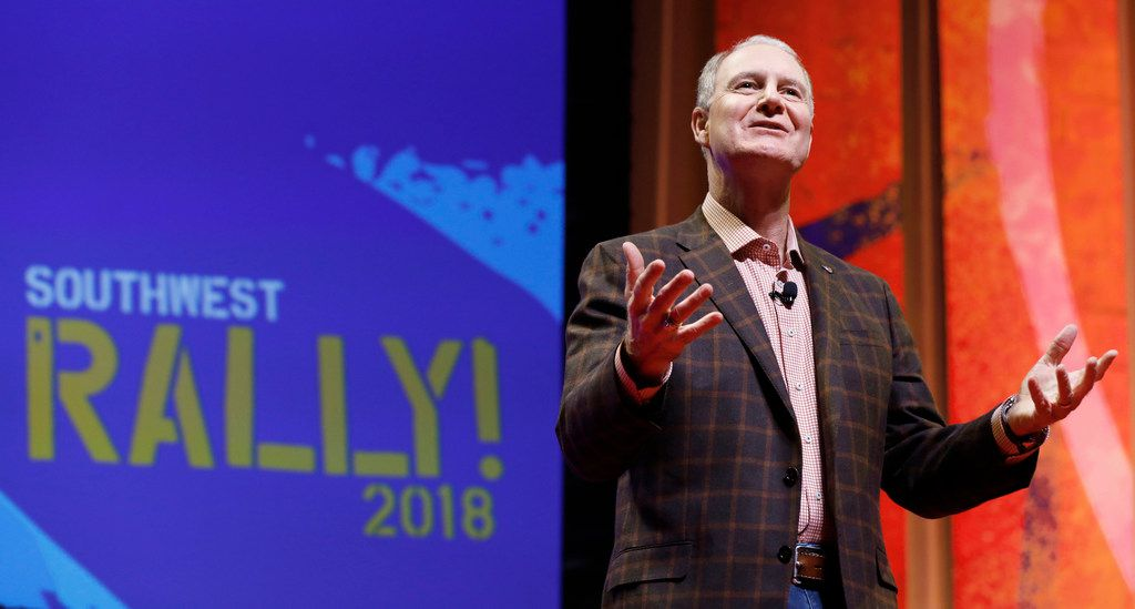 Southwest Airlines CEO Gary Kelly talks to employees at a company rally at Verizon Theater in Grand Prairie, Monday.