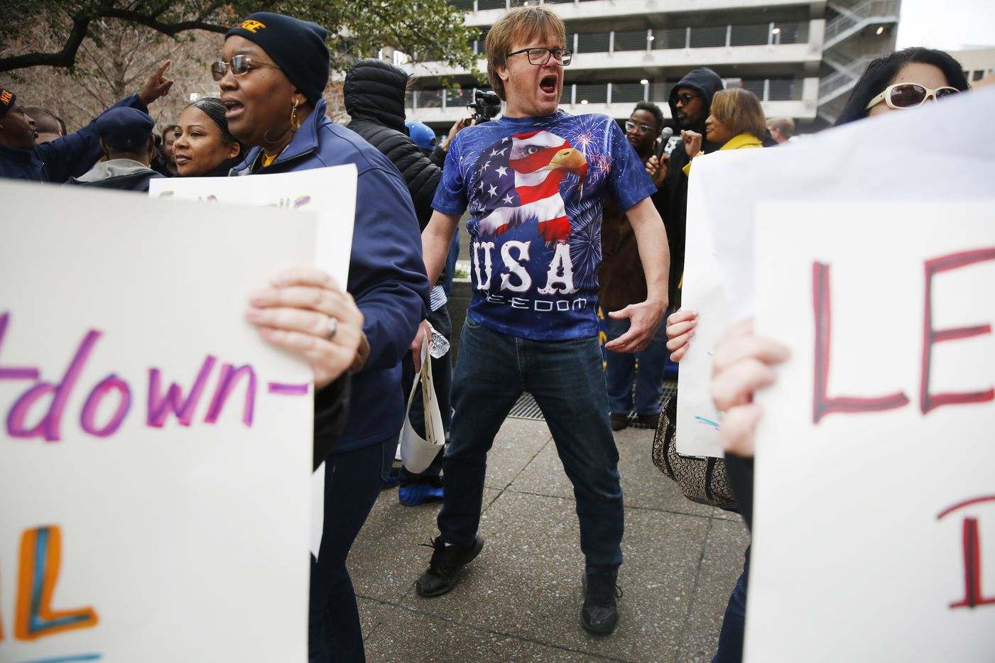 Charles Hermes yells during a rally protesting the partial government shutdown in downtown Dallas.