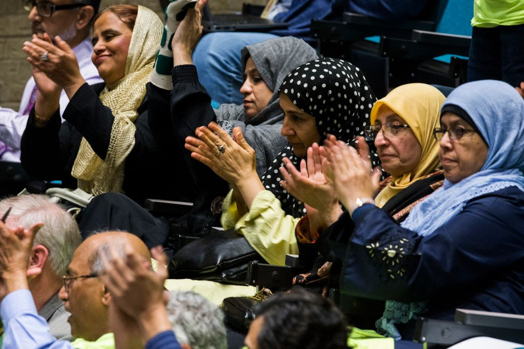 Plano citizens applaud a speaker during a hearing in which Plano City Council member Tom Harrison defends his post on social media about banning Islam in public schools on Monday, April 23, 2018 at Plano City Hall. The council is considering a recall of the November 6 election. (Ashley Landis/The Dallas Morning News)