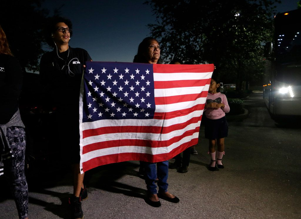 Antonia Catalon holds an American flag during a rally in support of immigrants who came into the U.S. as children, outside the office of Sen. Marco Rubio in Doral, Fla.