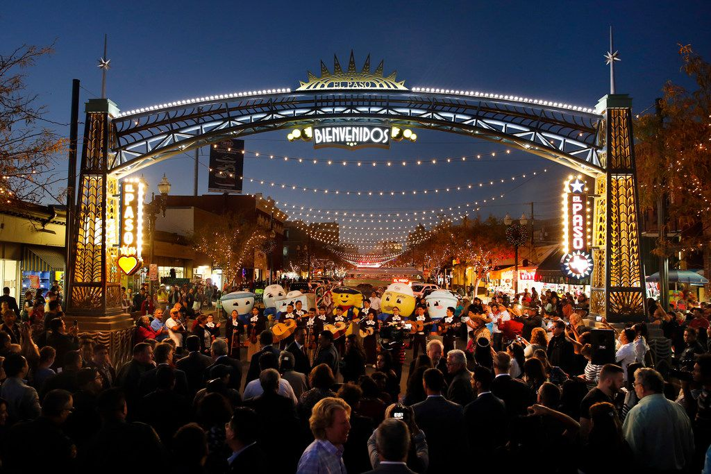 People gathered around a gateway arch to celebrate the lighting of S. El Paso St during the Paseo de Las Luces grand opening, Wednesday, November 7, 2018.  The project is a $6.4 million investment in El Paso's downtown shopping district. It has long been the gateway to Juarez, Mexico leading to the bridge and its border crossing. They hope to do the same on the other side of the Rio Grande River enhancing the area between the Santa Fe International Bridge and San Jacinto Plaza.