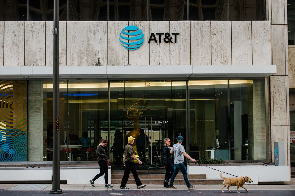A federal judge sided with AT&T in an antitrust battle between the Dallas-based telecom and the Justice Department.