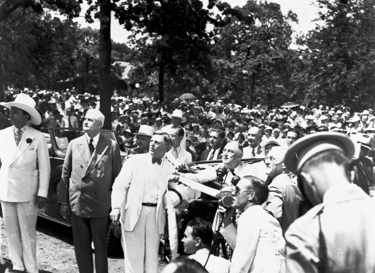 President Franklin D. Roosevelt (seated in an automobile) pulls a ribbon to unveil the statue of Robert E. Lee in front of a crowd at Lee Park in Dallas, Texas, on June 12, 1936. Pres. Roosevelt also spoke at the Texas Centennial Exposition at the Cotton Bowl in Fair Park earlier in the day.