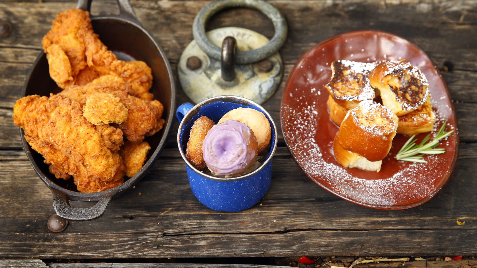 (from left) Nashville-style spicy fried chicken, daily donuts and baby fried toast (hand-cut challah, soaked in vanilla custard and topped with house-made rosemary syrup) are served from the Jam 'N Toast brunch menu at The Rustic on Howell St. in Dallas, Sunday, April 28, 2019.