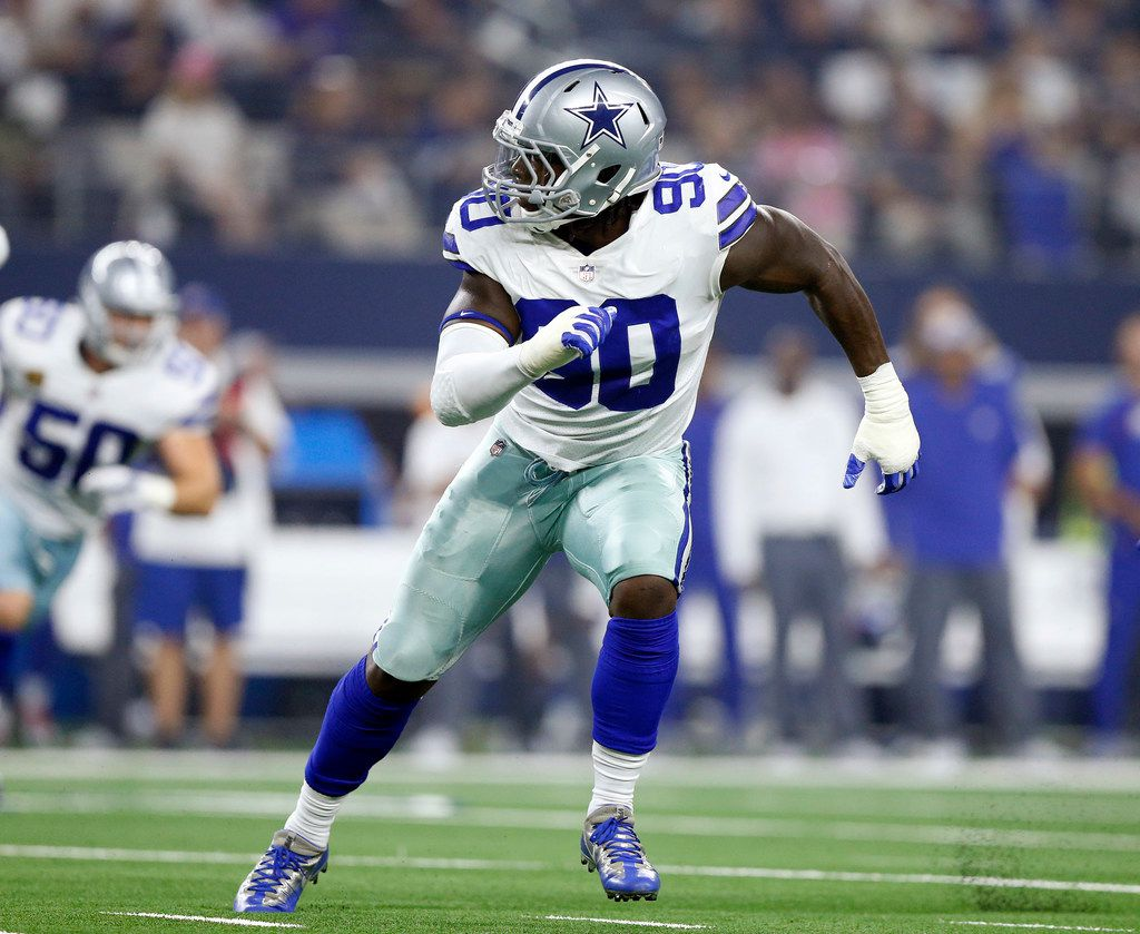 FILE - Cowboys defensive end DeMarcus Lawrence (90) pulls to his left as the New York Giants run a play during the first quarter at AT&T Stadium in Arlington, Texas, Sunday, September 16, 2018. (Tom Fox/The Dallas Morning News)
