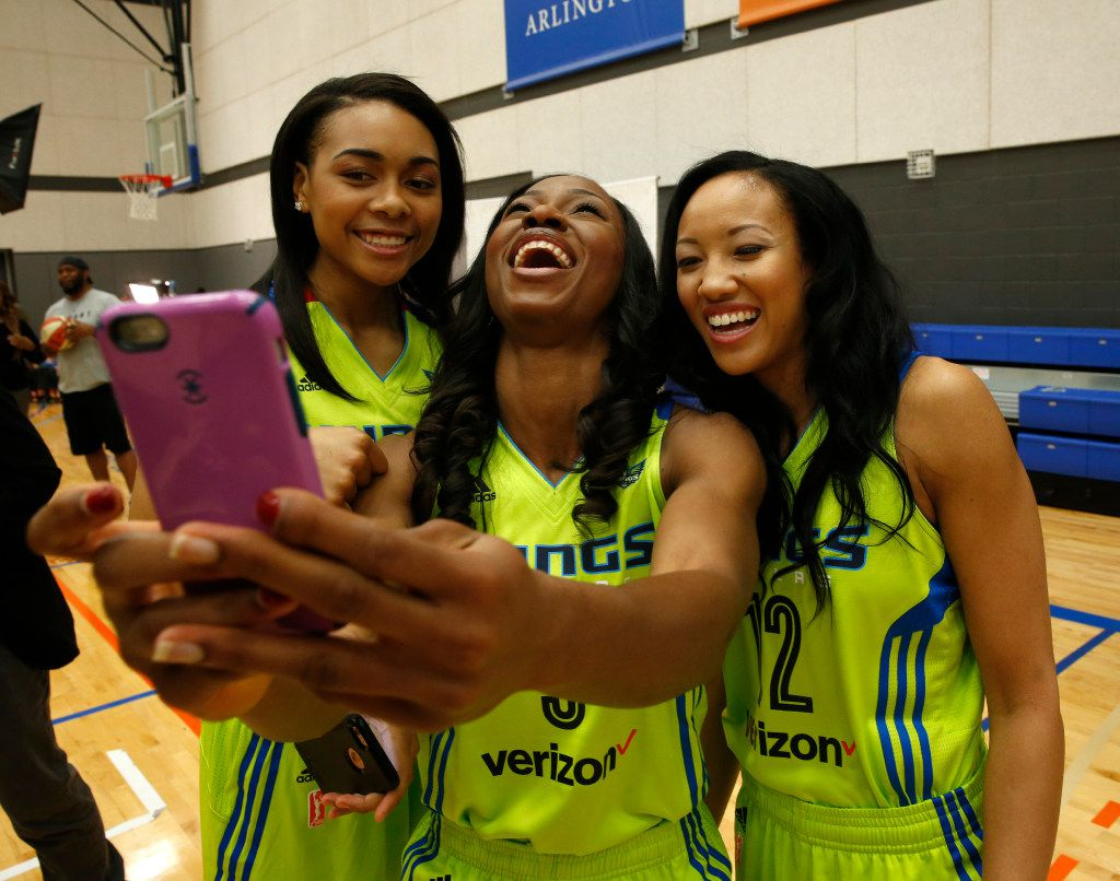 Allisha Gray, (from left) Evelyn Akhator and Saniya Chong pose for a selfie during Dallas Wings media day College Park Center in Arlington, Texas on May 2, 2017. (Nathan Hunsinger/The Dallas Morning News)