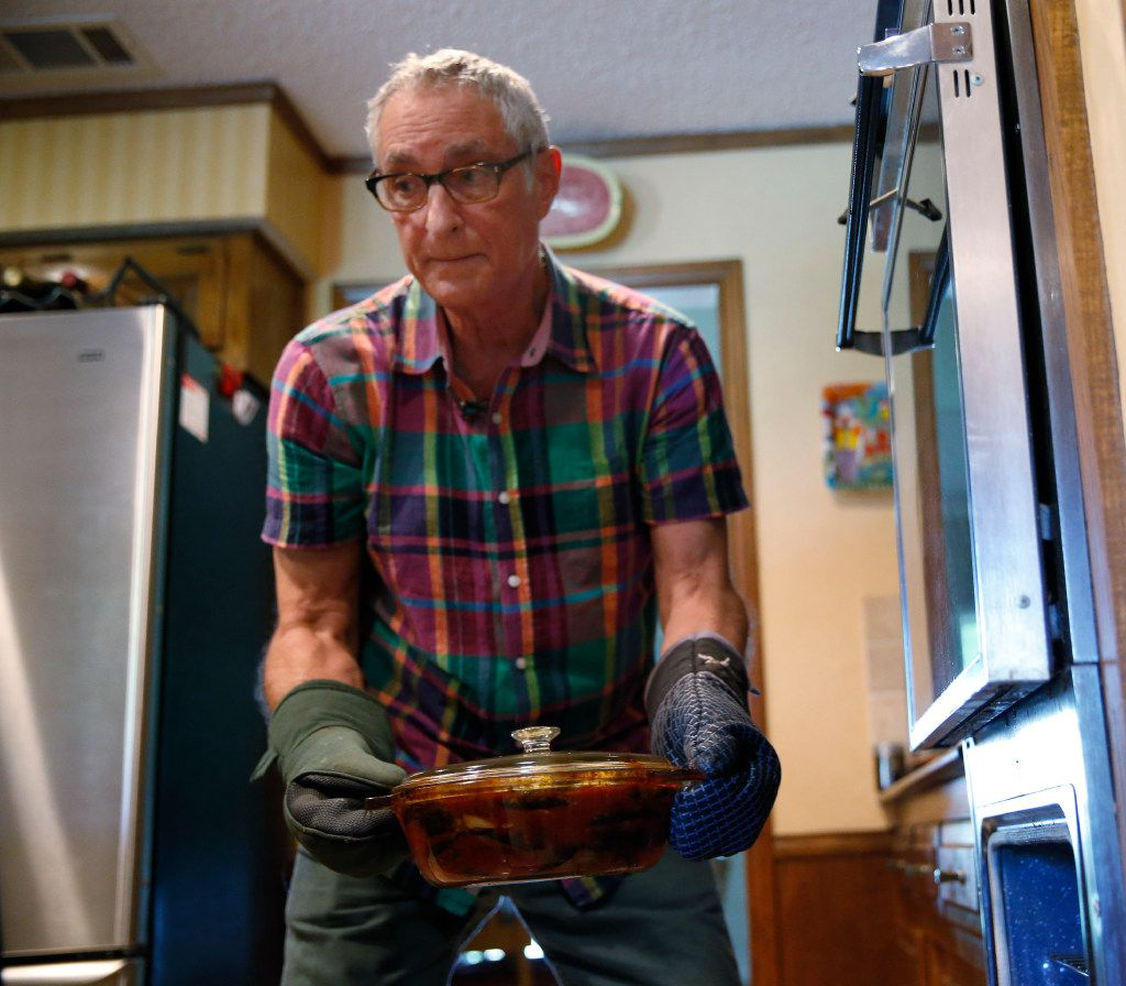 Alfonso Cevola takes a completed Eggplant Parmigiana out of the oven.